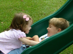 My children playing in our new yard on the first day in our new home.  They were 4 1/2 and 18 months.